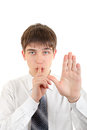 Finger on lips in silence gesture teenager with his and stop isolated the white background Royalty Free Stock Images