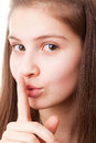 Finger on lips tsss portrait teenager girl a white background Stock Photo