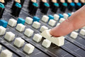 Finger on Mixing Desk Royalty Free Stock Image