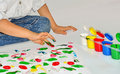 Finger painting cute little boy paints with her fingers with different color paint Royalty Free Stock Images