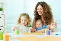Finger painting happy mother and kids doing Royalty Free Stock Images