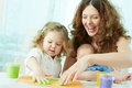 Finger painting happy mother and kids doing Stock Photo