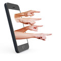 Finger pointing out of smartphone Stock Images