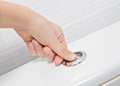 Finger pushing button and flushing toilet Royalty Free Stock Photo