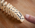 Finger pushing domino pieces line of Royalty Free Stock Photos