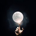Finger reaching moon planet Royalty Free Stock Photo