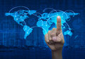 Finger touching on the touch screen with world map and city back Royalty Free Stock Photo