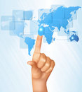 Finger touching world map on a touch screen. Royalty Free Stock Image