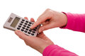 Finger is typing on a pocket calculator Stock Photos