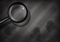 Fingerprints and magnifying glass on dark patterned surface Stock Photos