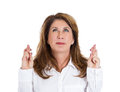Fingers crossed closeup portrait sad worried concerned woman mother crossing her hoping asking for best isolated white background Royalty Free Stock Photos