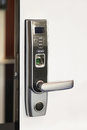 Fingertip lock biometric at modern home door Royalty Free Stock Photo