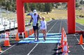 Finish line man and boy cross hand in hand Stock Image