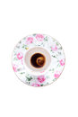 Finished cup of turkish coffee viewed from above in a dainty pretty floral porcelain and saucer decorated with pink roses Stock Photography