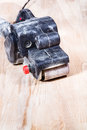 Finishing ashwood furniture board by belt sander hand held Stock Image