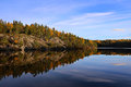 Finland autumn colours by a lake calm in Royalty Free Stock Photos