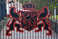 Finnish coat of arms border is closed steel fence and national emblem iron red lion Stock Photography