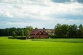 Large Finnish mansion in the middles on a wheat farm Royalty Free Stock Photo