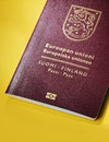 Finnish passport finland on yellow background this is the new design of the Stock Images