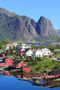 Fiords and mountains of reine in lofoten the village for the times magazine the most beautiful place the world Stock Photo