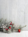 Fir branch with Christmas decorations on  wooden plank. Royalty Free Stock Photo