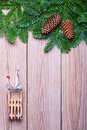 Fir branches and christmas decorations on wooden boards Royalty Free Stock Images
