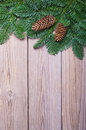Fir branches with cones on boards wooden Royalty Free Stock Image
