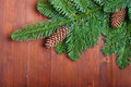 Fir branches with cones on wooden boards Royalty Free Stock Photography