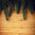 Fir branches on wood Royalty Free Stock Photos