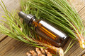 Fir oil bottle of essential on wooden board Royalty Free Stock Photo