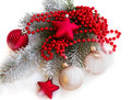 Fir tree branch with christmas decorations Stock Photos