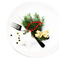 Fir tree branch and christmas table place setting with christma ornaments copy space for greeting text on white plate Stock Photography