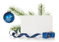Fir tree branch with christmas toy and blank card a a serpentine souvenirs a isolated on white Royalty Free Stock Images