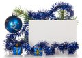 Fir tree branch with tinsel small gift boxes a christmas toy and a card isolated on white Stock Image