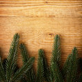 Fir tree branches on wood Royalty Free Stock Photo