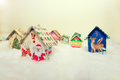 Fir tree decoration: handmade houses with Christmas ornaments Royalty Free Stock Photo