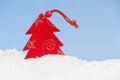 Fir tree toy in snow on sky background Royalty Free Stock Images