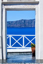 Fira the capital of santorini island in greece view to sea and volcano through a door from Royalty Free Stock Photography