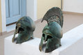 Fira santorini greece two ancient iron helmets replicas in town island Stock Images