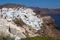 Fira santorini with its typical typical white houses at the top of a steep hill with a blue dome church greek island of Stock Photos