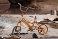 Fire aftermath childs bicycle destroyed by bushfire Stock Images