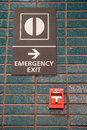 Fire alarm and emergency exit sign Royalty Free Stock Photo