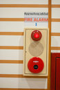 Fire alarm on green wall Stock Images