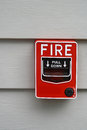 Fire alarm switch ongray wall Stock Photos