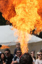 Fire breather performing to a crowd of people Stock Photos