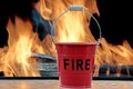 Fire bucket and flames xxxl Royalty Free Stock Images