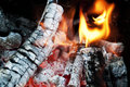 Fire from burning firewood with ashes and flames red hot coals in an oven Stock Images