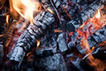 Fire from burning firewood with ashes and flames red hot coals in an oven Stock Photography
