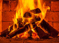A fire burns in a fireplace Royalty Free Stock Photo