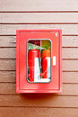 Fire cabinet extinguisher in red on wall Stock Images